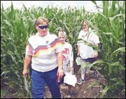 Visiting from Lawrence, Kathy Cobb, Michael Torneden, 9, and Wendy Reed make their way through the rows of corn that form the butterfly maze. Owner John Pendleton hopes attendance to the maze will top 10,000 this year.