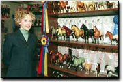 Erin Zirbels love for horses shows in her collection of horse figurines that line the walls of her basement. Since Zirbel has been riding, she has also accumulated rows of ribbons and trophies from her equestrian competitions.