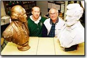 DeSoto High art teacher Tim Mispagel and Darrel Zimmerman strike their best Mt. Rushmore poses between the well-travelled busts of George Washington and Abraham Lincoln. Zimmerman hopes to return the busts to their original home.