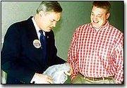 Mill Valley High School teacher Matt Bohm gives Dennis Moore a Jaguar shirt as the congressman toured the school Monday afternoon.