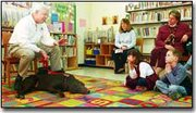 Under no circumstances should you pet a dog before asking his owner permission, Jim McCrossen told children and their parents at the DeSoto Library. McCrossen and his dog Kaffee visited the library to give a presentation on dog safety last Thursday.