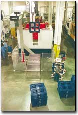 A machine unloads a finished plastic pallet at the Rehrig Pacific Company. Production started at the plant the first week of January.