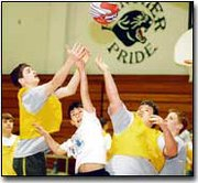 It's a battle for a good cause as a group of Lexington Trails eighth-grade boys jump for a rebound while playing a game at Hoops for Hearts. Each grade played various basketball games for about an hour and a half to participate in the event.