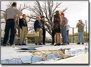 City officials and current and future De Soto City Council members discuss the repairs needed at the city pool during a special meeting last Thursday. De Soto Parks and Recreation Director Jay Garvin discovered large chunks of the pool's deck had deteriorated over the winter. The repairs will again be addressed at the regular city council meeting Thursday.