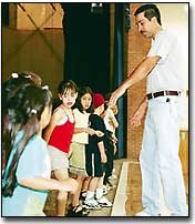 At a rehearsal last Saturday, Tony Valenzuela instructs children in a folk dance native to the city of Vera Cruz, Mexico. The 5- to 8-year-old children and a troupe of teenage dancers will perform at Saturday's De Soto Cinco de Mayo festival.