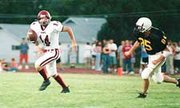 roger nomer/the Eudora News Eudora junior quarterback Kaleb Niedens avoids a Paola tackler during last year's victory at Paola. This year, the Cardinals take on Paola for the first game of the season this Friday.