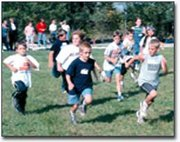 Tonganoxie elementary students competed in the Tonganoxie Elementary Cross Country Meet last Wednesday at the Tonganoxie course. Tucker Conrad, front right, keeps an eye on Ben Higbee, while Vinnie Angel runs behind. Complete results are listed on page 2B.