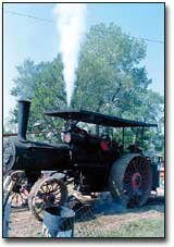 The old Rumely filled the sky with steam Sunday morning as it powered the sawmill. The engine is now owned by B.J. and Charlotte Robinson, McLouth, and was originally owned by Herman Watson, founder of the threshing bee.