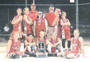 The Tonganoxie Braves celebrate a tournament title last month in Johnson County. On Monday, the team will compete in a national tournament in Oklahoma City. Pictured front row from left are Hannah Herrstrom, Sarah Flaherty, Ashlee Lohman, Sammi Rush and Tracie Hileman; middle row, Melissa Pratt, Amie Riddle, Amanda Albert, Holly Luke and Chrissie Jeannin; back row, coaches Pat Albert and Craig Lohman.