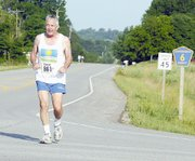 Al Pursell, Leavenworth, heads east on Evans Road during the library's run. Pursell, who is 75, was the oldest runner to participate in the 10K.