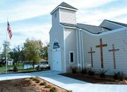 Tonganoxie's Assembly of God Church, damaged in the May 2000 tornado, is now rebuilt. Members plan a dedication service and open house on Dec. 9. See story, page 6A.