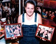 Katie Brest has photos of the Backstreet boys throughout her bedroom, both framed and unframed.