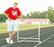 Bill Shaw looks at home on the track at Tonganoxie High School's Beatty Field. But Shaw is moving on. He's retired from THS and this fall will teach in the De Soto school district. Shaw will continue coaching girls track in Tonganoxie next school year, on a part-time basis.