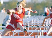 Rachel Bogard competes in the hurdles at Basehor earlier in the season. Bogard was fighting the flu on Friday and did not compete at Gardner.