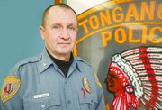 Ken Carpenter in back on duty -- stateside, in his role as Tonganoxie police chief. Carpenter recently returned from a stint on active duty with the U.S. military in Iraq, where he spent most of his time in the Iraqi capital of Baghdad.