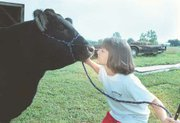 Casey and Bo, her 15-month-old steer that weighs in at 1,200 pounds, look each other eye to eye.