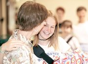 Kathie Clarke gives Hilary Saathoff a hug as school ends for the year. In the fall, Clarke will be back to start her first full year as administrator of Genesis Christian Academy.