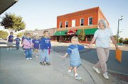 Roberta Rountree holds hands with Bailey Salmon as they cross the street. Other children pictured, from left, are Matt Johnson, Alyssa Sharp, Dessie Forshee, Michayla Mikesic, Michael Mast and Taylor Hamon.