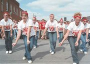 The Tonganoxie High School Dance Team members showed their school spirit at Friday's homecoming pep rally, held downtown on Fourth Street. From left are Lauren Donnelly, Laura Samuels, Desirae Rieke, Casey Worden, Lindsey Starcher, Courtney Hoffines and Jennifer Saultz.