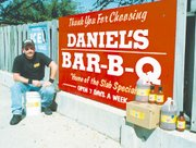 Daniel Hipsher stays busy between operating his restaurant on U.S. Highway 24-40 and competing in barbecue cook-offs. Hipsher has won several awards for his sauces and meats. And he's launching a new flavor this fall.