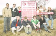 Tonganoxie debaters have new signs, but no place to put them. Students pictured back row from left are Jeff Gravatt, Jason Smith, Linsey High, Heather Young, Levi Huseman, Heather Harrison and Kaitlyn Kelly. Pictured front row, from left, are Jake Williams, Ben Jefferies, Garrett Kelly and Erin Holton. Not pictured is Tim Leffert.