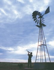 Jerrod Pearce takes aim while hunting for dove in Comanche County, in southwest Kansas, with his father.