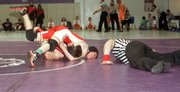 Tonganoxie sophomore Ross Starcher works on a pin enroute to a title in the 135-pound division Saturday at the Baldwin Invitational. The Chieftains finished fifth out of 10 teams.