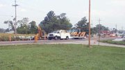 Gas company workers prepare to fix the broken line at the intersection of U.S. Highway 24-40 and Fifth Street.