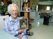 Gertrude Miller holds a photo of herself taken when she was just 16.