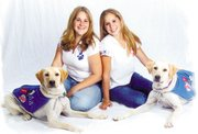 Erin Drozinski, left, poses with Adobe, and Nicole poses with Barley. Adobe and Barley are brother and sister.