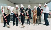 Mayor/CEO Carol Marinovich, of the Unified Government of Wyandotte County and Kansas City, Kansas, participated in a 2002 groundbreaking ceremony in Village West. Marinovich is third from right.