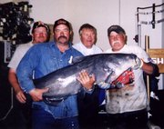 John Coulter, Scott Jacobs, Chester Pickens and Charlie Fatherley pose with their catch just before the fish is put into the aquarium at Cabela's.