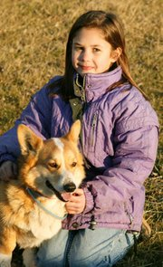 Hadley DeHoff, pictured here with the family's dog, also works with cattle and horses.