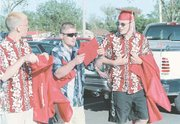 Tonganoxie High School seniors Chris Mullins, left, Steve Adcox and Chad Vukas, arrived early to prepare for Saturday's graduation ceremony held at Beatty Field.