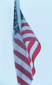A thin sheet of ice coated the flag above the post office Wednesday afternoon.