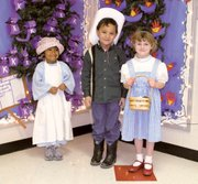 At Tonganoxie Elementary School on Kansas Day, three kindergarten students in Debbie Wedel's classroom dressed for Kansas Day. From left are Maggie Parsons and her brother, Kendall Parsons, and Harlan Shoemaker. Maggie and Kendall are the children of Byron and Janie Parsons and Harlan is the daughter of Doug and Heather Shoemaker.