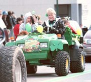 Celebrating the luck of the Irish were dozens of parade entrants. Above, Bev Oroke drives a carload of leprechauns along the parade route. Also pictured are her daughter Carey Oroke, in the passenger seat, and her granddaughter Morgan Oroke, in the back.