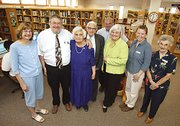 The Tonganoxie City Library was dedicated to Winnie Turner Saturday. Turner served as librarian from February 1969 to May 1995 and was instrumental in the planning of the current library. From left are family members and library representatives: Sandy Turner, Jim Morey, Winnie Turner, Robert Turner, Bobby Turner, Karen Pence, Sharon Moreland and Betty Nelson.