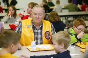 Casey Jones, one of the oldest members of Linwood Lions Club, enjoys lunch at school with the children.