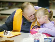 Linwood Lions Club member John Winsor sat by his granddaughter, first-grader Haley Barns, when the Lions were treated to lunch at Linwood Elementary School.