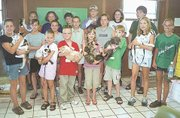 Cats hissed and growled as some of the 4-H'ers who participated in Saturday's pet show posed for a quick photo. Back row, from left, are: Nicole Allen, Erin Sours, Jennifer McCue, Alan Bauerly, Mary Grasela and Jeffrey Gibbens. Middle row, Beth Edmonds, Mary Kate Theis, Natalie Loreti and Rita Edmonds. Front row, Jennifer Ciszewski, Hannah Gee, Ben Forshee, Marilyn Megee, Tracy Bowersox, Amanda Douglas and Lauren Ellis.