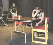 Amelia Coffin talks over her problems with Kathryn Keyes, who filled in as Ginger's grandmother at Friday's rehearsal.