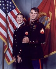 Shannon and Ray Phillips pose in their Marine uniforms. Now, the Phillips have enlisted in the U.S. Air Force.