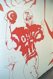 This football player is part of a mural in the THS boys locker room that graduate Thomas Gilner created last month.