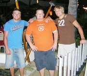 Nick Stein, center, poses with Great Bend teammates Brent Meter, left, and Keith Rathbun, while in Hawaii.