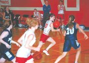 Laura Jeannin, Tonganoxie freshman basketball player, brings the ball up the court against Mill Valley on Feb. 22. The girls completed a 20-0 season.