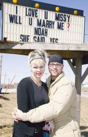 Noah Bedell last week asked Missie Von Hallberg to marry him on the sign outside of Helen's Hilltop, where Von Hallberg works.