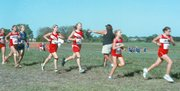 Elizabeth Smith, second from right, and teammate Kelley Stauch, far right, compete during the Tonganoxie Invitational earlier this fall. The Chieftain girls finished fourth in the Kaw Valley League and seventh in regionals, while the boys team finished second at league, third at regionals and 12th at state.