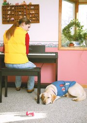 Barley takes a snooze as Nicole Allen practices the piano. At Tonganoxie Christian Church, when Nicole plays the piano on Sundays, Barley accompanies her, sitting beneath the piano bench.