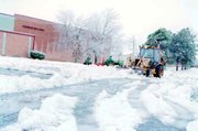 Snow plows rumbled through the parking lot of Tonganoxie High School late Thursday afternoon.